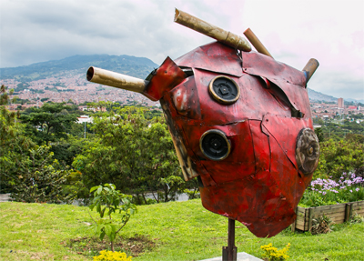 Sculpture of a heart, constructed of recycled garbage.