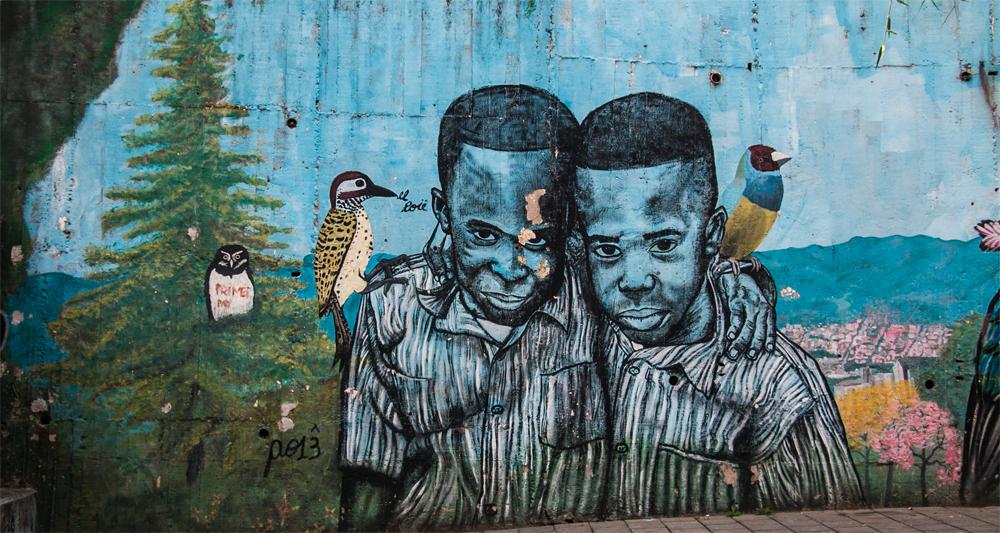 Comuna 13 Medellin Colombia: Graffiti of two boys hugging