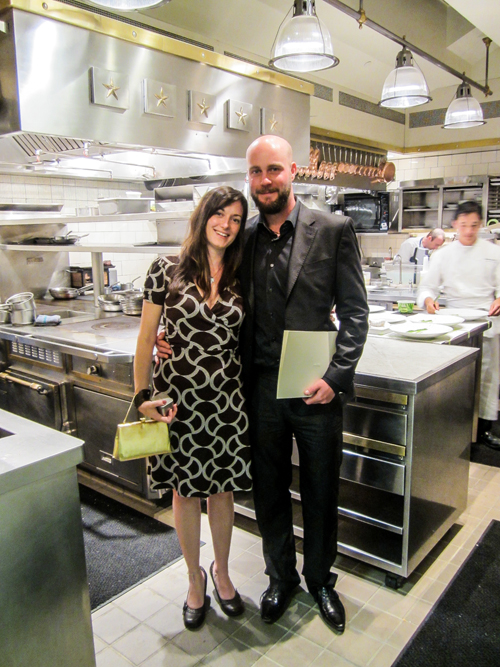 Mark and Kylee dressed up and standing in the French Laundry kitchen.