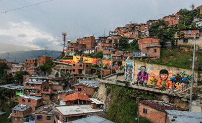 Shanty town with a wall of colourful graffiti