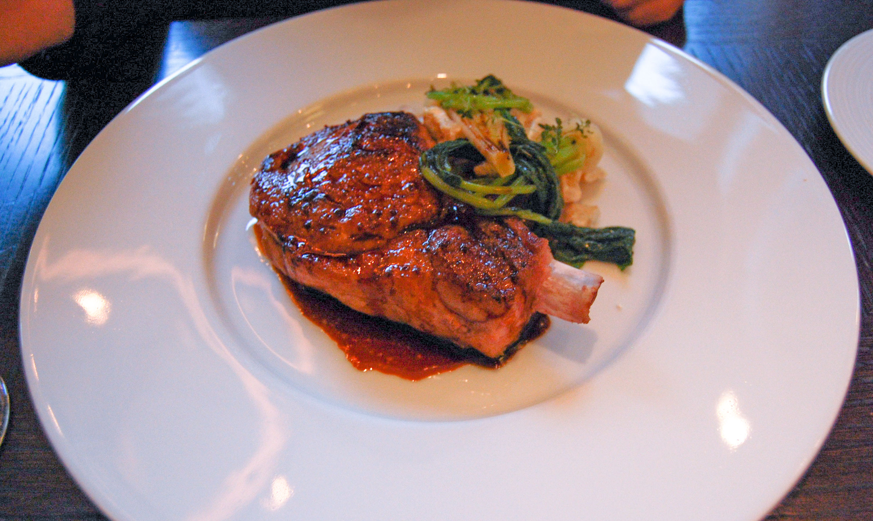 A pork chop on a plate