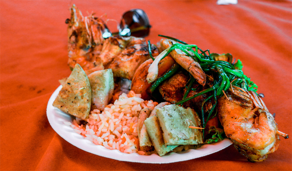 In the Ruta de las Flores in El Salvador, eat delicious food like these grilled prawns