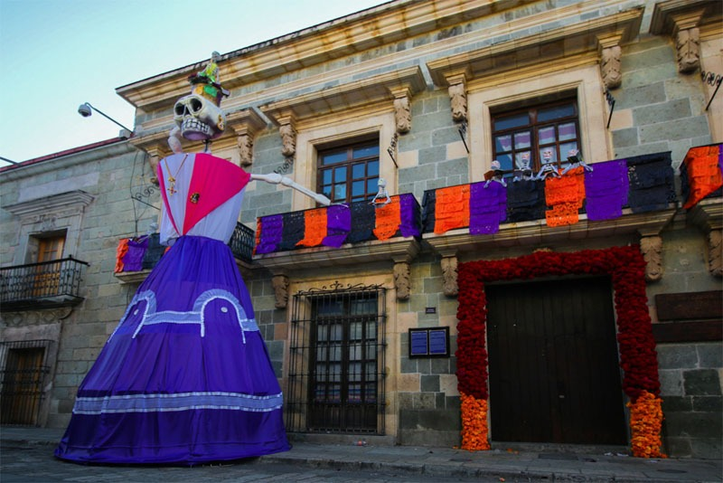 A purple and orange decorated skeleton for the day of the dead celebrations in Oaxaca