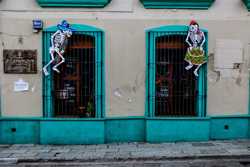 Bright blue window frames decorated with skeletons
