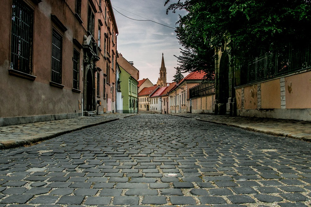 An empty alleyway with cobbled street in a medieval city