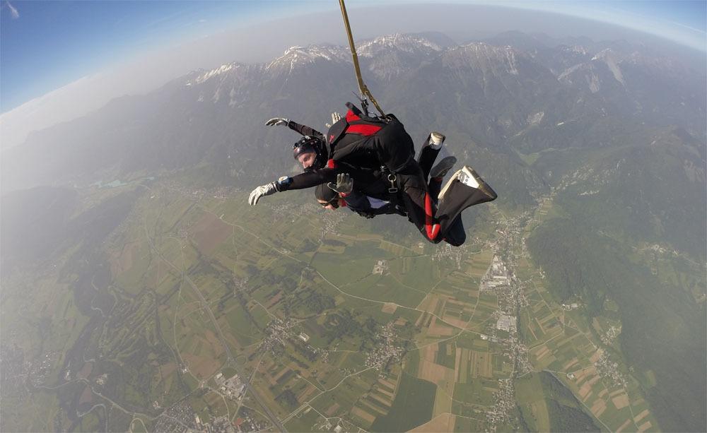 Two people tandem skydiving