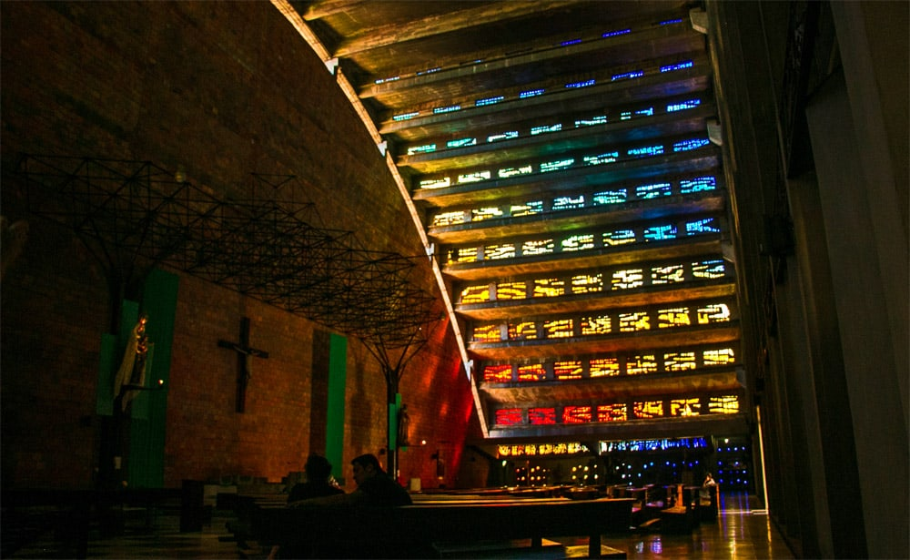 A cathedral in San Salvador with rainbow coloured glass in the ceiling