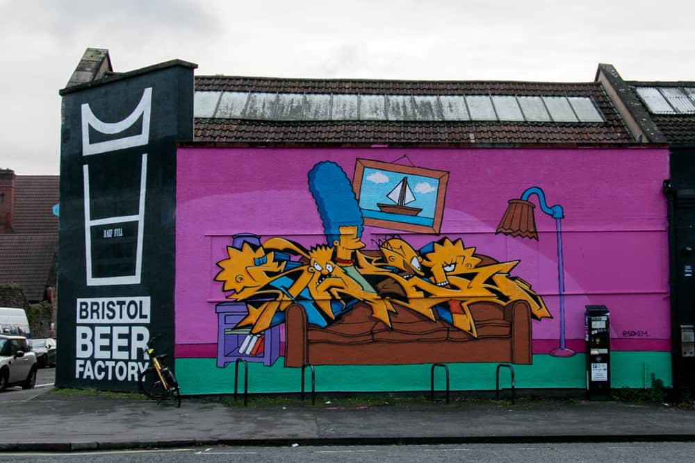 Graffiti featuring 'The Simpsons' on a bar wall