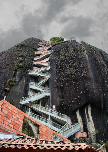 The towering rock with a staircase climbing the side