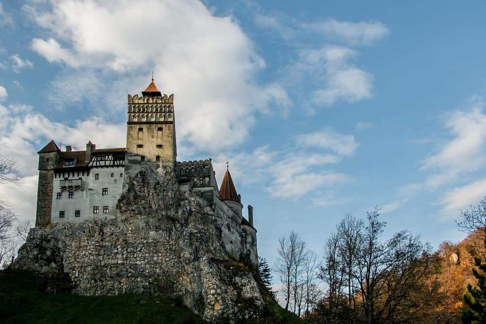A menacing castle on a mountain cliff in Romania