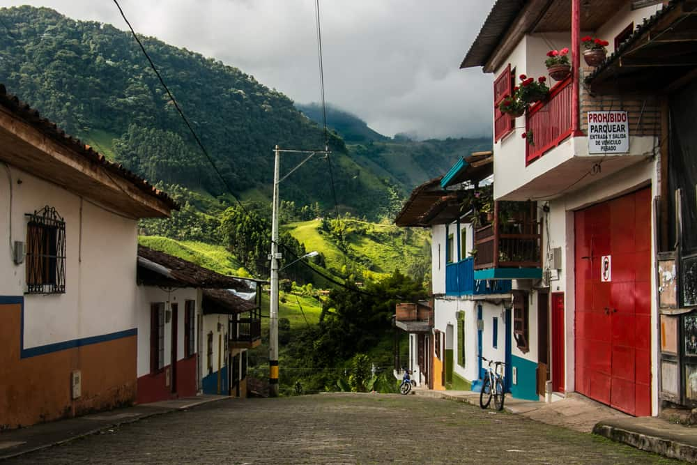 Colourful buildings of Jardin Colombia with green valley in the background