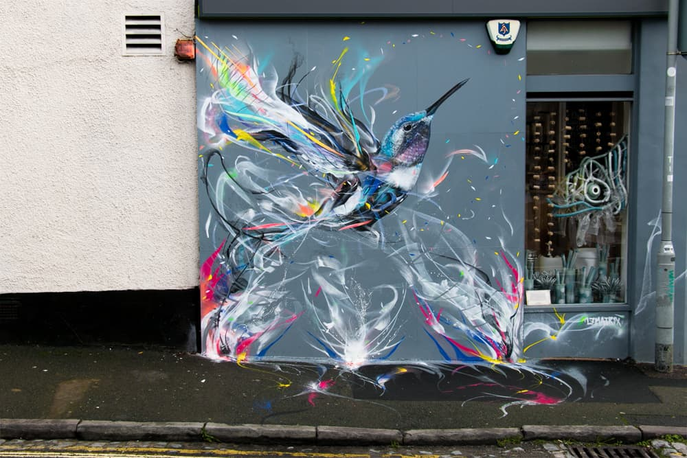 Vivid colours sprayed on a wall, graffiti hummingbird
