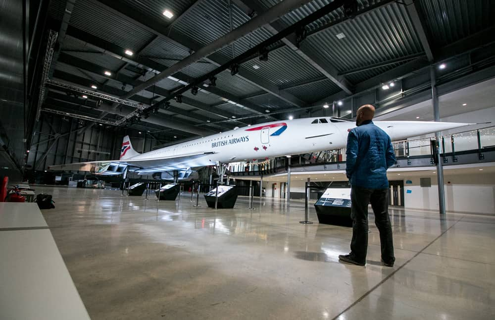 Man standing in front of Concorde jet at Aerospace Bristol