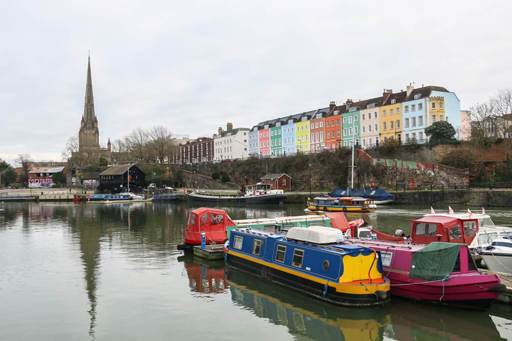 Colourful boats and buildings over a harbour in Bristol UK