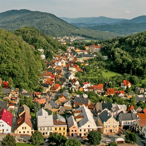 A colourful village in a green valley