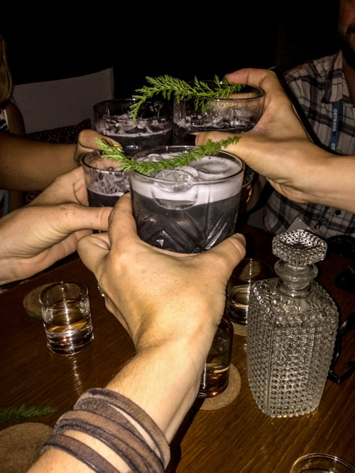 Several glasses toasting at an Ostrava pub.