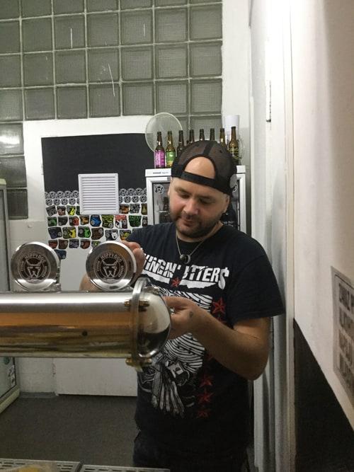 A bartender pours craft beer