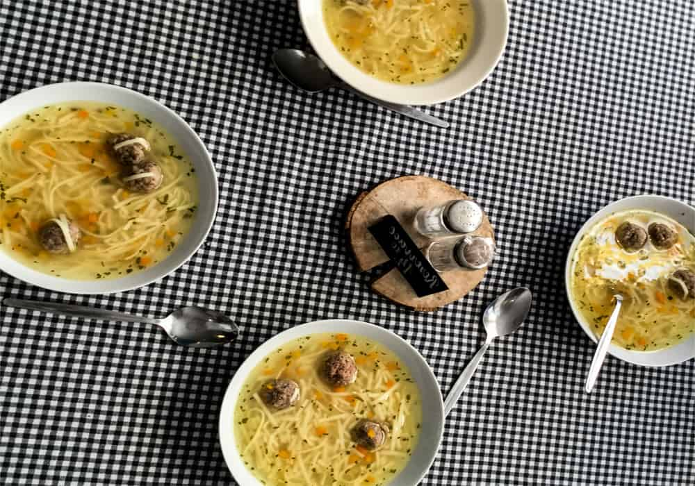 Several bowls of soup on a table