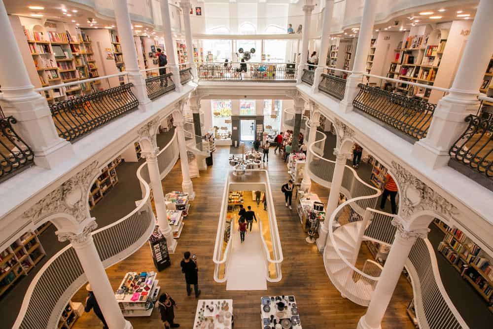 interior of a white bookstore with several levels in Bucharest Romania