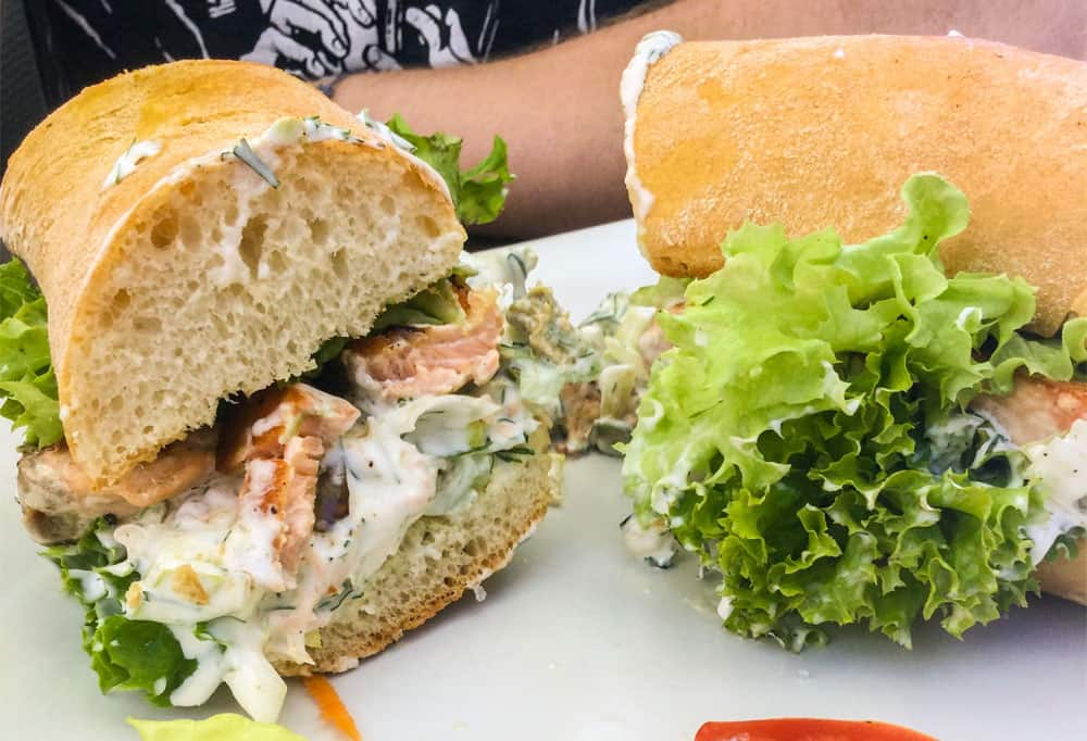 Sandwiches with salmon and a white sauce