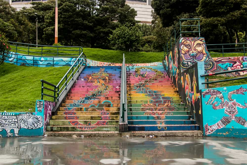 Stairs in a park, completely covered in multi-coloured graffiti