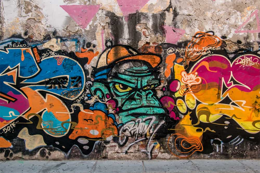 Messy graffiti tagging with a monkey painted in the middle