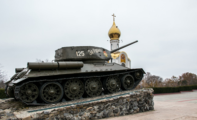 A Soviet tank in front of an orthodox cathedral