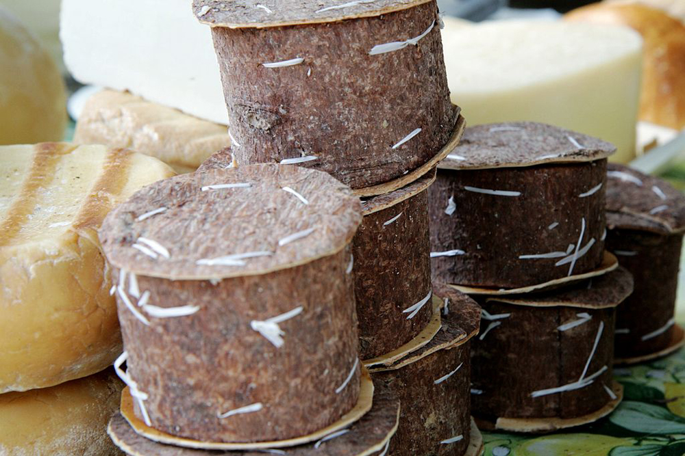 Tree bark bundles that are filled with Romanian cheese