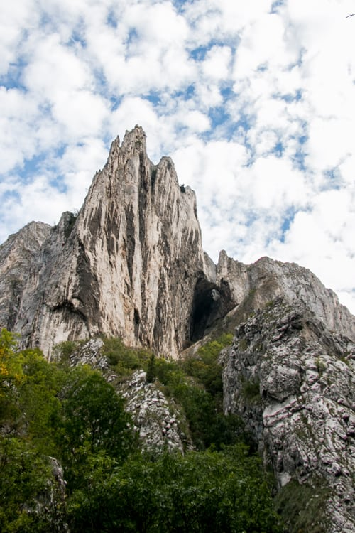Sharp limestone mountain jutting up from Turda Gorge in Romania