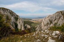 View over a Romanian landscape of prairies from high up a cliff at Turda Gorge