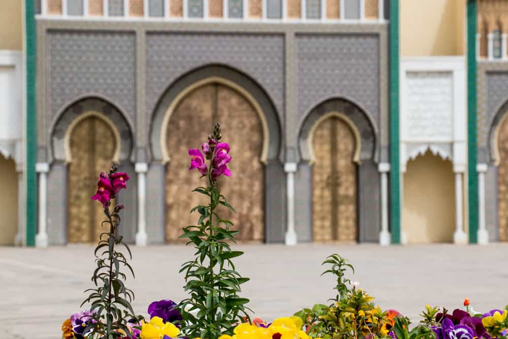 A flower stands in front of the palace doors in Fes
