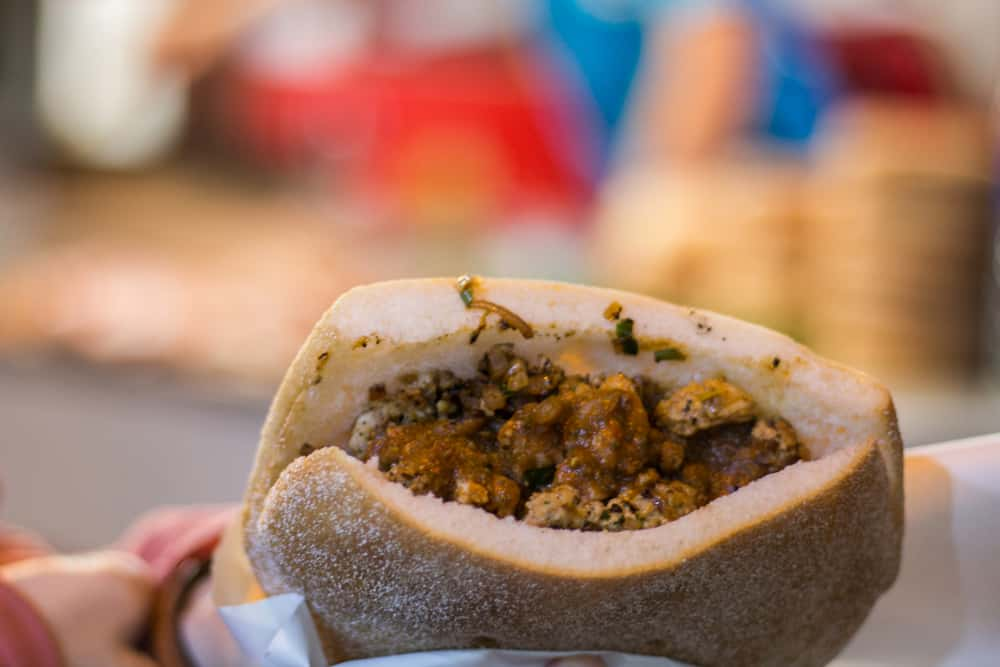 Street food sanwich in Morocco, a bun filled with meat and onions with sauce