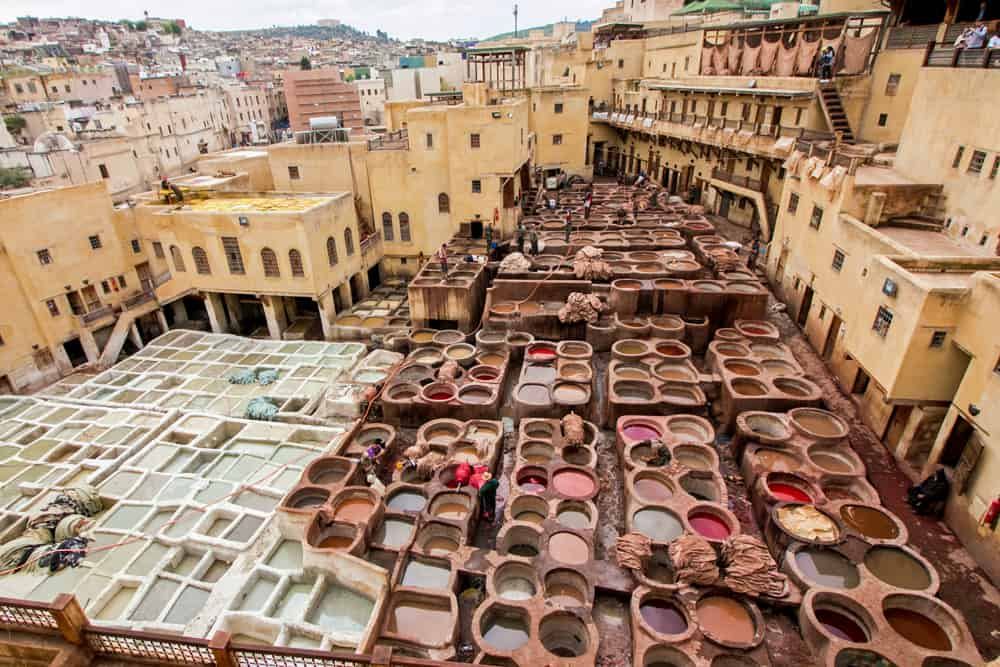 Ancient stone vats of curing and dying liquids in the Fes Tanneries