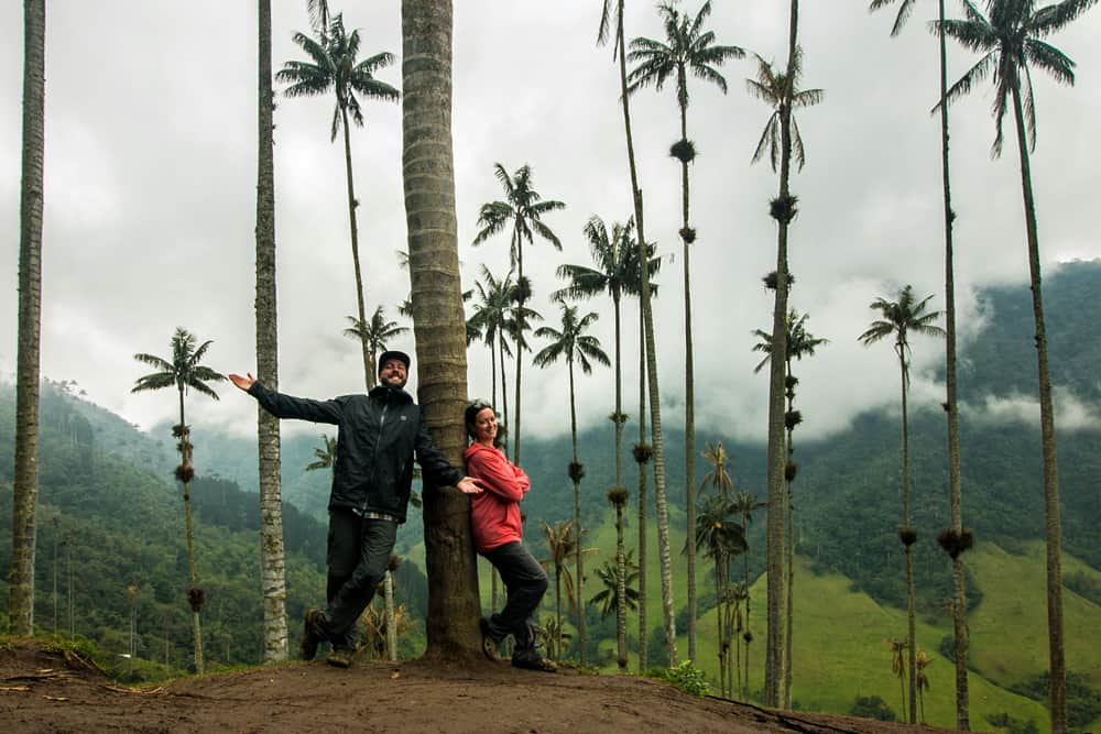 Kylee and Mark under palm trees in Colombia.