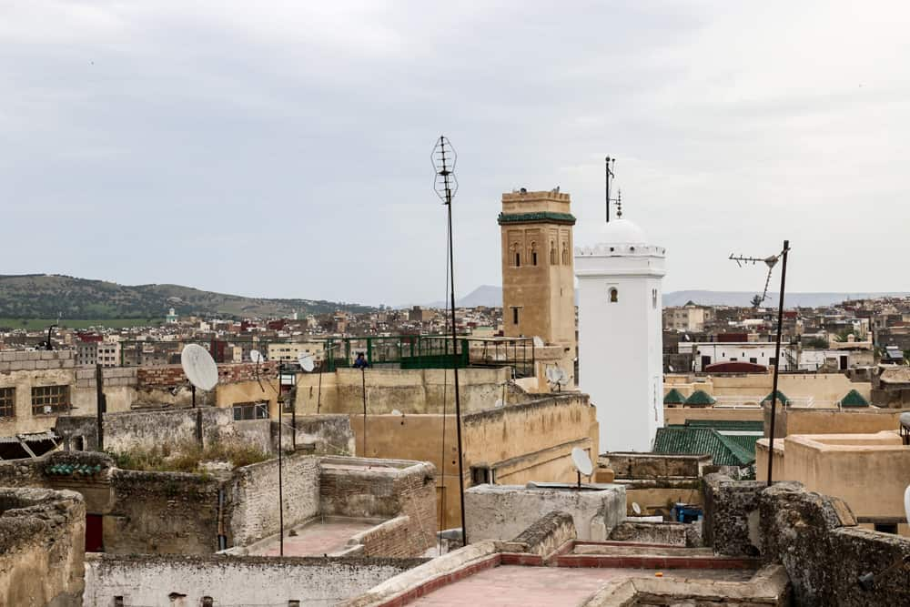 Rooftops and the minaret of a mosque as part of the Fes skyline