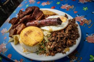 Plate of meat and eggs and arice