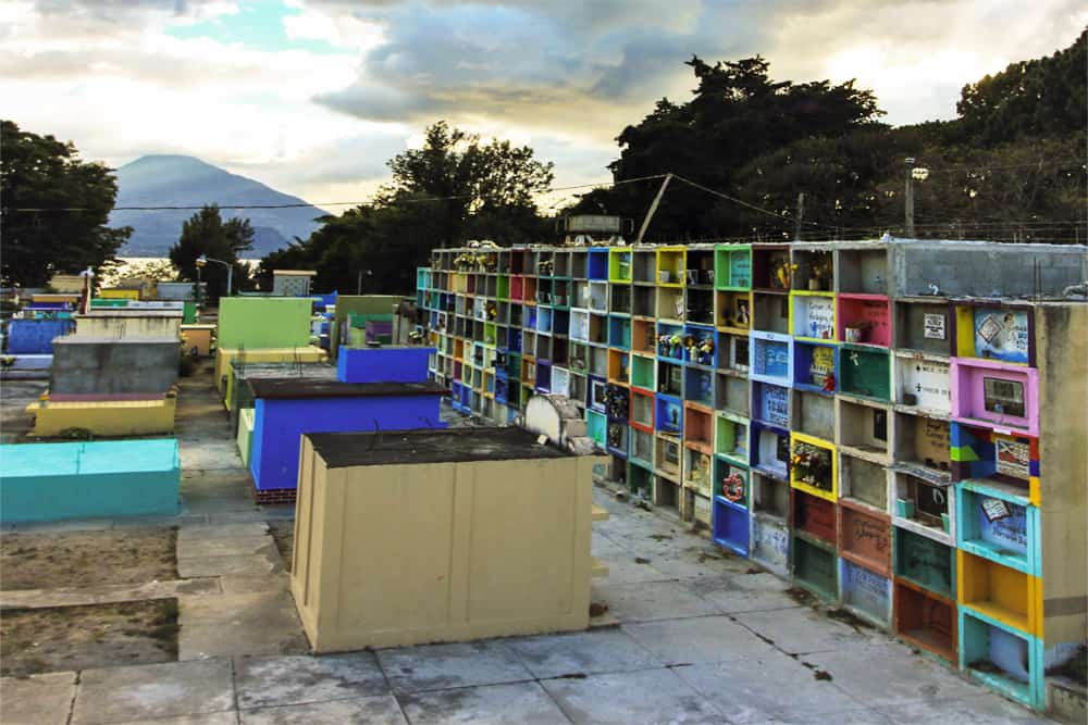 Colourful concrete caskets in a Guatemalan cemetery.