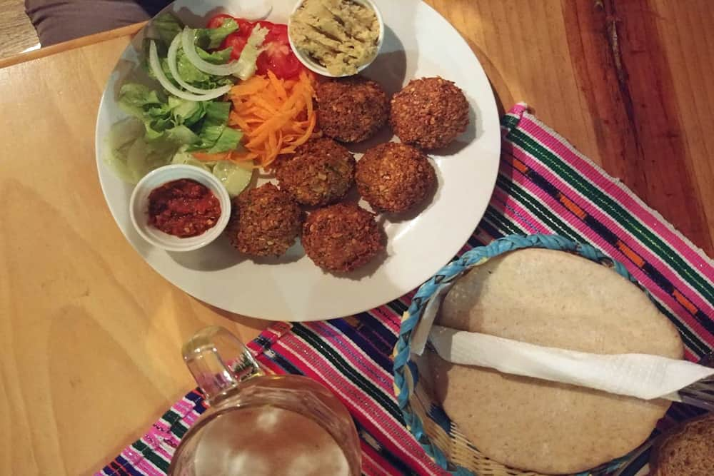 Plate with fried falafels and salad, with tortillas on the side at a Lake Atitlan restaurant