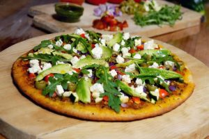 Flatbread pizza with avocado.