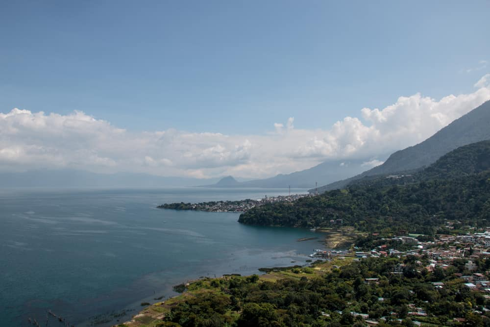 Lake Atitlan - large lake with a volcano beside it and a village on the shore