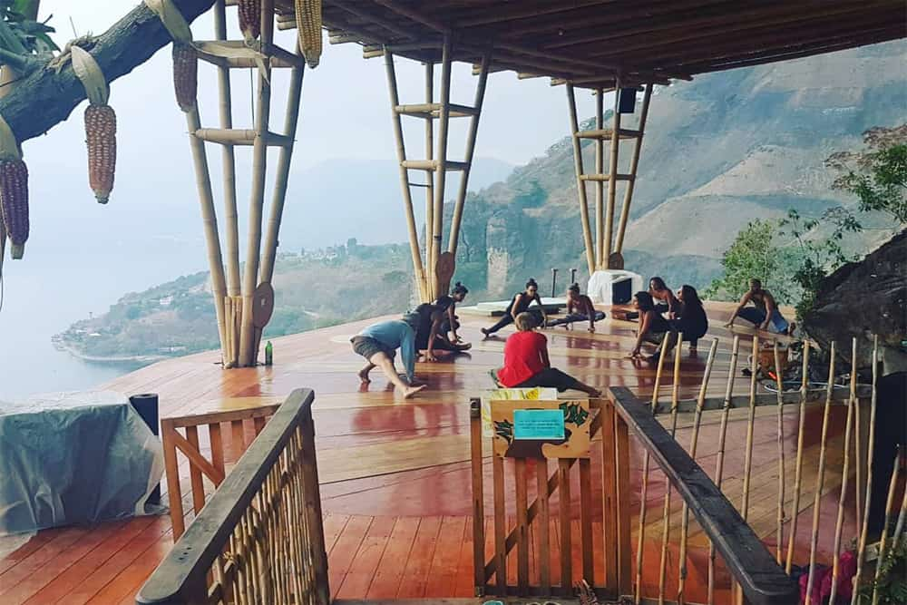 People doing yoga on a platform in San Marcos overlooking Lake Atitlan.
