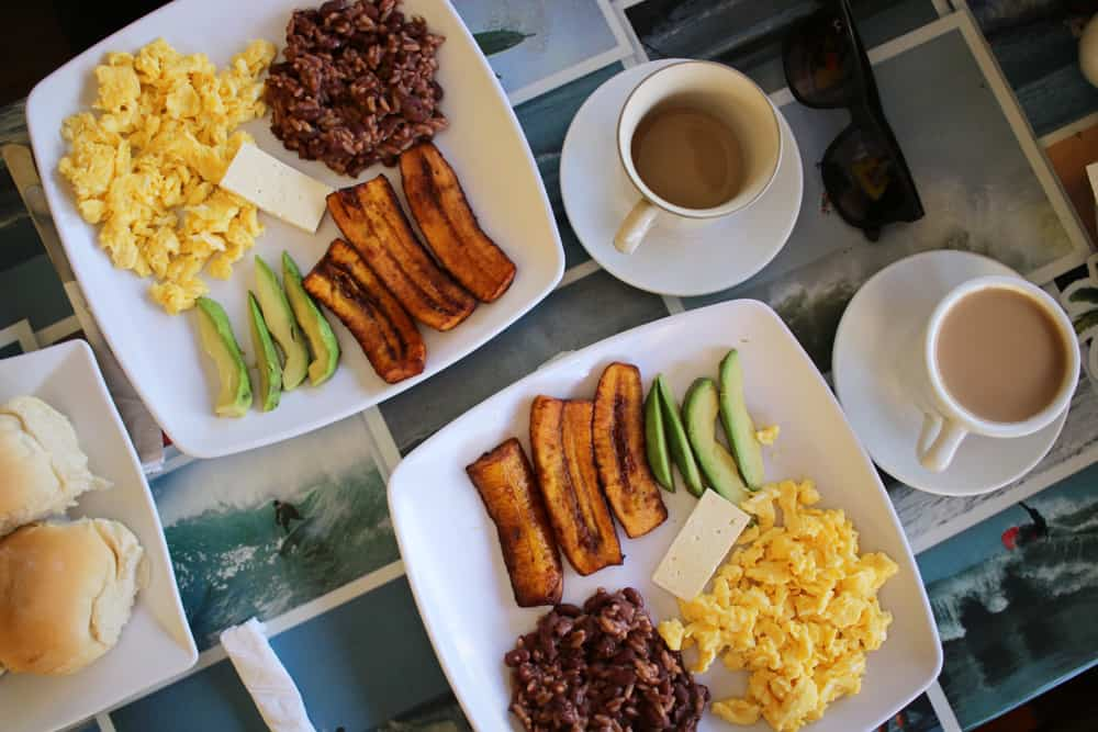 Two plates with breakfast items on them in El Salvador