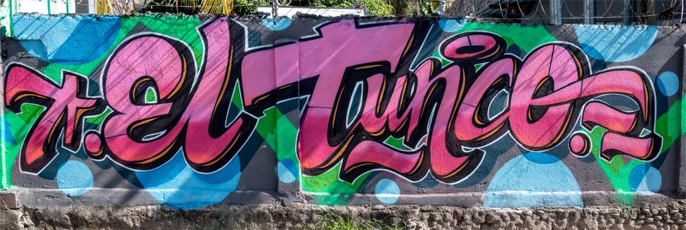 Pink graffiti letters spelling El Tunco