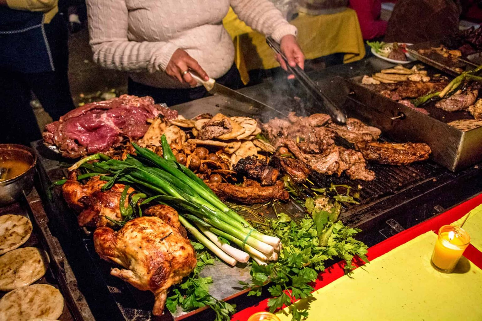 Meat and vegetables grilling at the Juayua Food Festival in El Salvador
