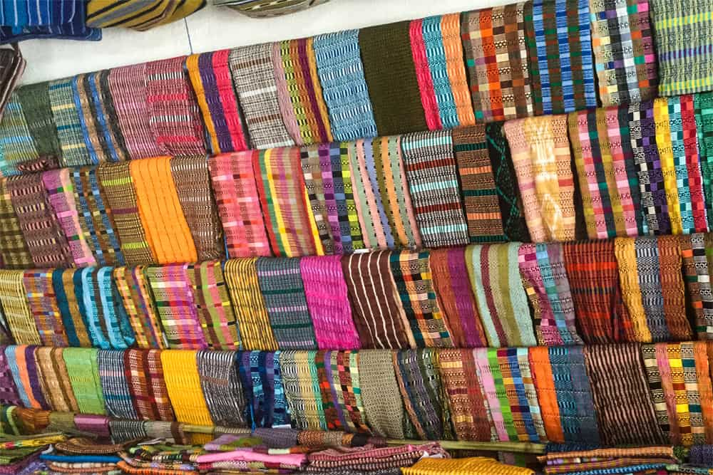 Different woven fabrics, many different colours, in Guatemala