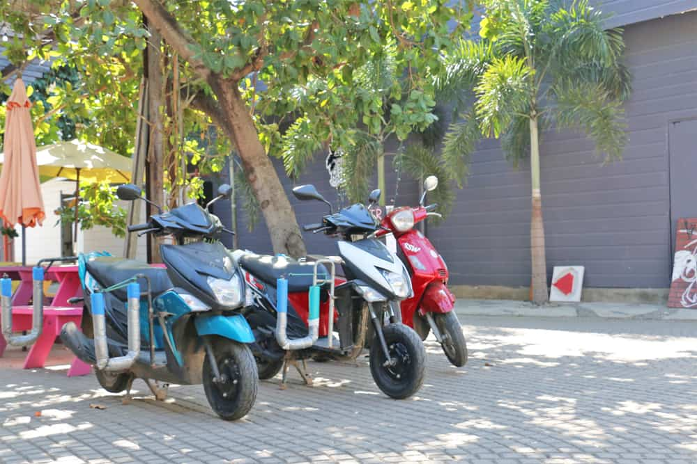 Three moto-scooters in a row, with surf racks attached in El Tunco El Salvador