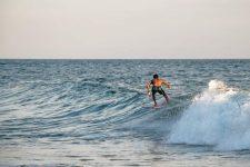 Surfer rides a wave in El Salvador
