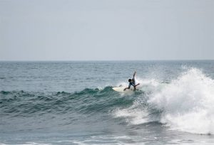 Surfer on a wave in El Zonte El Salvador
