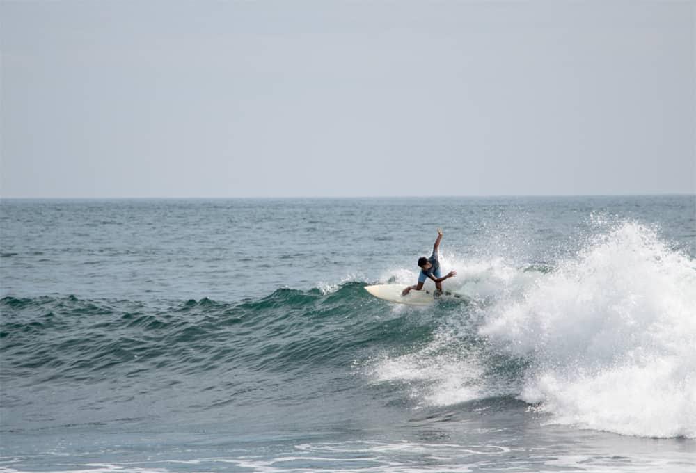 Surfer on a wave in El Zonte El Salvador