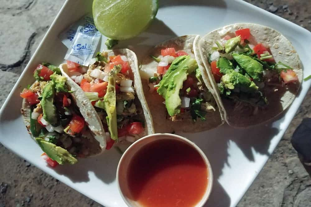 Plate of four tacos and salsa